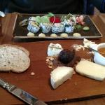 Sushi and cheese tray in bar/restaurant.