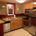 The kitchenette area with a full-size stove & refrigerator.