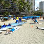 Beach in front of hotel with array of hire gear.