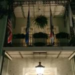 View of the Bienville House entrance and balconies on Decatur Street