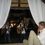 Being serenaded by the local band on one of the large beds next to the bar