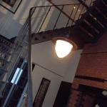 The fabulous industrial stairs from the bathroom up to the bed chamber..