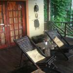 nice covered deck/porch with hammocks, chairs, books etc