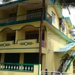 Front view  of Palm Fringe (Yellow House)