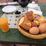 Breakfast - boiled eggs, french stick, pastry, olives, jam, dairy lee type cheese, tea, coffee a