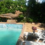 Inviting pool with beautiful sculpture art
