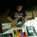Local artist making great painting in front of you