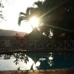 The sun sets over the pool at RIO VISTA RESORT