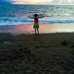 My 6 year old at the beach in front of the hotel at sunset