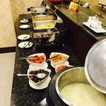 simple breakfast buffet includes coffee, buns, bread, porridge, cooked veggies; you could find m