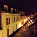 Looking down rue Porion on a rainy night