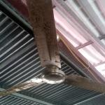 Very dirty ceiling fan over restaurant tables