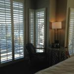 shutters all around the bedroom