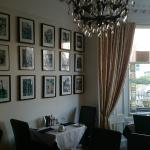 Lovely dining room with pictures of Edinburgh Festival