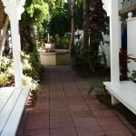 Walkway behind pool to our room