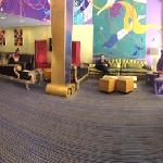 Panoramic of hotel lobby. Whimsical decor featuring Kimpton's standard free coffee and tea in th