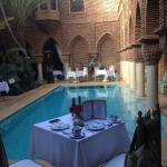 Breakfast by the swimming-pool
