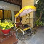 The cyclo on display at the front of the hotel