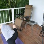 mango the cat only visited for yoga on the porch