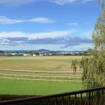 View over racecourse to Lake Rotorua from balcony of room 313