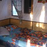Room E5, 2 single beds, ancient aircon but worked + wall fan