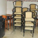 stacks of chairs - but none available for my room - also note the  refrigerator & microwave