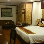 Superior room with sofa in corner, nice and warm hotel