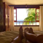 Sit in bed listen to waves & view the ocean