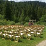 Large lawn in front of a creek and hills for outdoor weddings