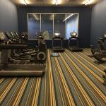 Hotel gym - 3 treadmills and a few ellipticals and some free weights