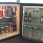 The in-room fridge is stocked with all kinds of drinks.