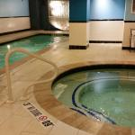 Pool and jacuzzi in hotel basement.