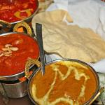 Assorted curries with poppadoms