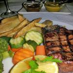 Tender fillet steak with veg and chips
