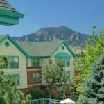 Homewood Suites Boulder Hotel Exterior with Rocky Mountains