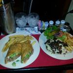 Awesome room service! Swiss mushroom burger and fries and Chipotle steak wrap with fries!