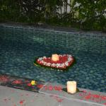 Pool decorated for bride and groom in their villa on wedding night
