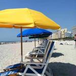Looking down the beach from rented umbrella and chairs
