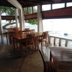 restaurant open seating area. lovely view out with sound of the waves