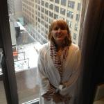 Room with a view in an animal print hotel robe