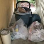 Garbage piled up by stairway