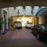 Hotel entrance and valet parking with natural light