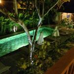 view of the pool at nighttime from my spacious veranda