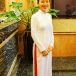receptionist Jenny in traditional dress