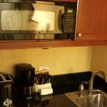 fridge, micro, coffeemaker, toaster, sink, plates, cups