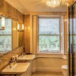 The under-floor heated bathroom has both bath and shower with fluffy bathrobes, slippers and lux