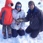 Mr Don teaching us to ice fish at Deep Creek Lake.