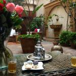Enjoying tea and pastries in the courtyard