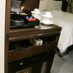 View of the room from entry-way.  Closeup of Keurig machine, teas, and well-stocked mini-bar/fri