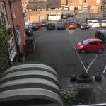 View of rear entrance and car park from room 124
